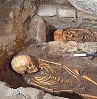 skeleton in stone coffin